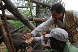 Donatella Knecht de Massy and Francisco Gordillo feeding the rhinos at the Victoria Falls National Park